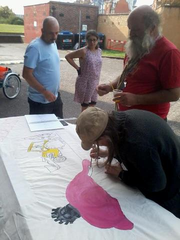 banner making at a solidariTEA meetings